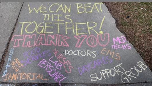 message of thanks written in chalk on sidewalk